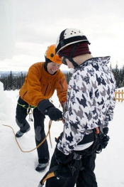 teen on 60 foot ice-climbing tower safety gear